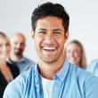 Confident young man smiling with in background - Stock Photo