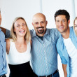 Royalty-Free Stock Photo: Joyful business team standing together