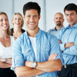 Royalty-Free Stock Photo: Successful business man with his team in background