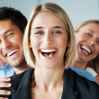 Royalty-Free Stock Photo: Smiling businesswoman leading her successful team