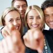 Sucessful team of business colleagues pointing at you - Stock Photo