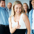 Success - Happy woman with thumbs up and excited at back - Stock Photo
