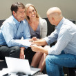 Financial advisor explaining investment plans to a couple - Stockfoto