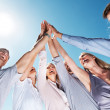 Business team celebrating success with high five - Stock Photo