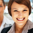 Happy female executive with group - Stock Photo