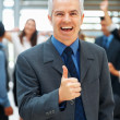 Royalty-Free Stock Photo: Successful executive supported by team