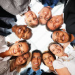 Business with their heads together in a circle - Stock Photo