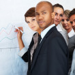 Executive drawing business graph - Stock Photo