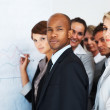 Royalty-Free Stock Photo: Executive standing with colleagues