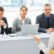 Interviewers in conversation with applicant - Stock Photo