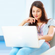 Cute girl using laptop - Stock Photo