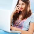 Pretty girl using laptop - Stock Photo