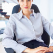 Woman sitting confidently - Stock Photo