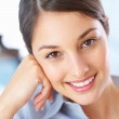 Beautiful businesswoman smiling - Stock Photo
