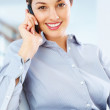 Smiling female executive talking on cellphone - Stock Photo