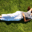 Royalty-Free Stock Photo: Relaxing woman on grass