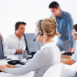 Call center employees with headset - Stock Photo