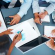 Accounting - Businesspeople working on charts and graphs - Stock Photo