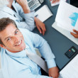 Confident male executive in a financial meeting - Foto Stock