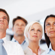 Visionary multi ethnic business group looking away - Stock Photo