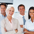 Royalty-Free Stock Photo: Happy young businesspeople standing together
