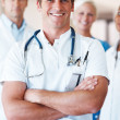 Royalty-Free Stock Photo: Cheerful young doctor leading his team