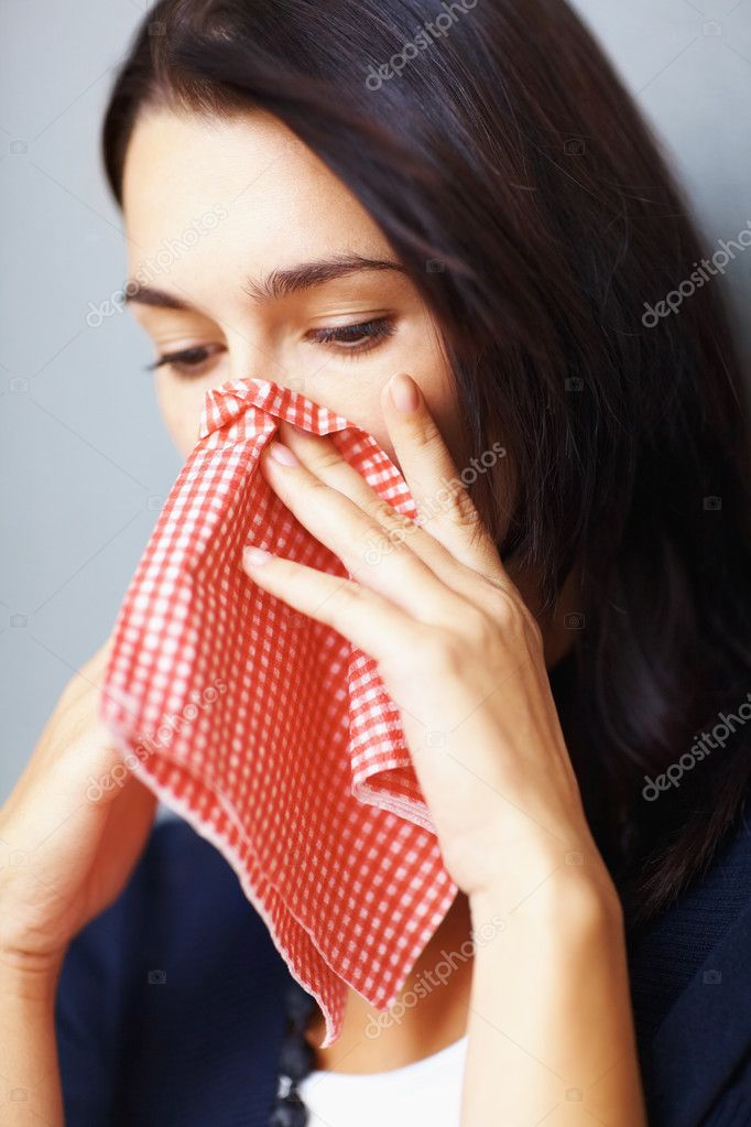 Young sick girl with handkerchief wiping her nose — Stock Photo #7780091