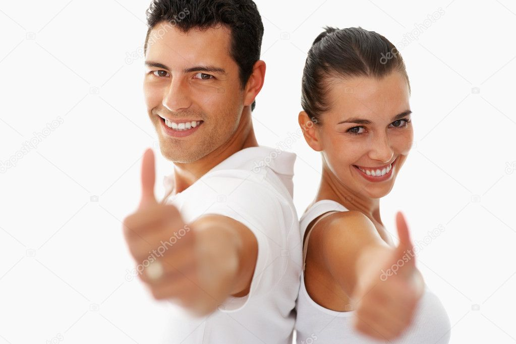 Young smiling with thumbs up gesture on white background — Stock Photo #7780272