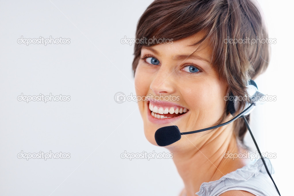 Closeup of smiling call center employee wearing headset on white background — Stock Photo #7781552