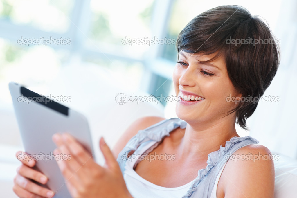 Smiling young woman using tablet PC — Stock Photo #7781751