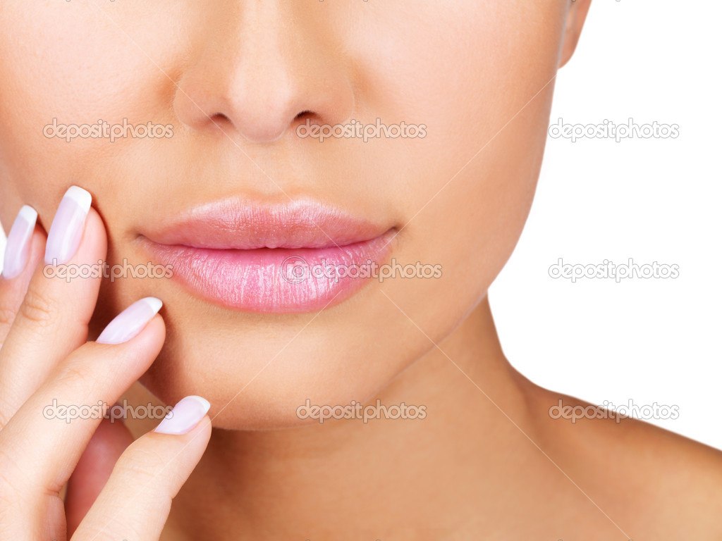 Closeup portrait of beautiful girl's lower part of face and manicured fingers — Stock Photo #7782308