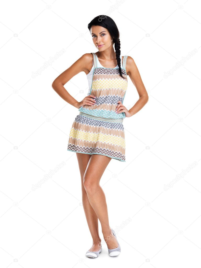 Full length of an attractive young woman posing confidently against white background — Stock Photo #7782475