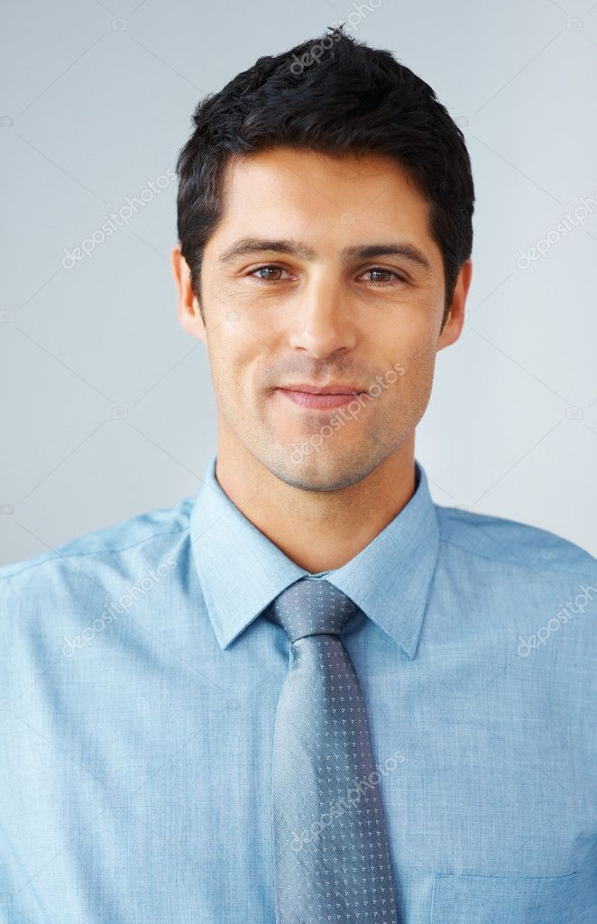 Closeup of businessman smiling  Stock Photo #7783402