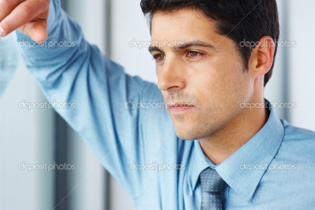Closeup of businessman looking out window — Stock Photo #7783403