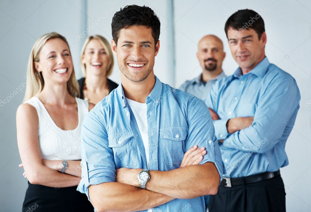 Portrait of a smart businessman standing with folded arms with his business team in background — Stock Photo #7784020