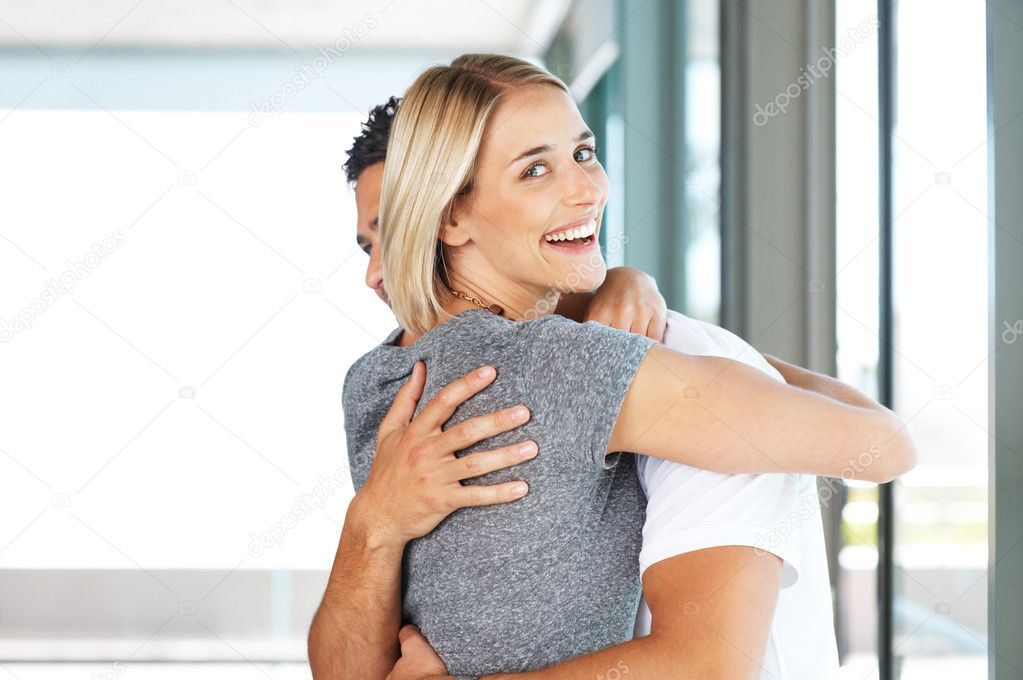 Portrait of a beautiful blond female hugging her boyfriend  Stock Photo #7784303