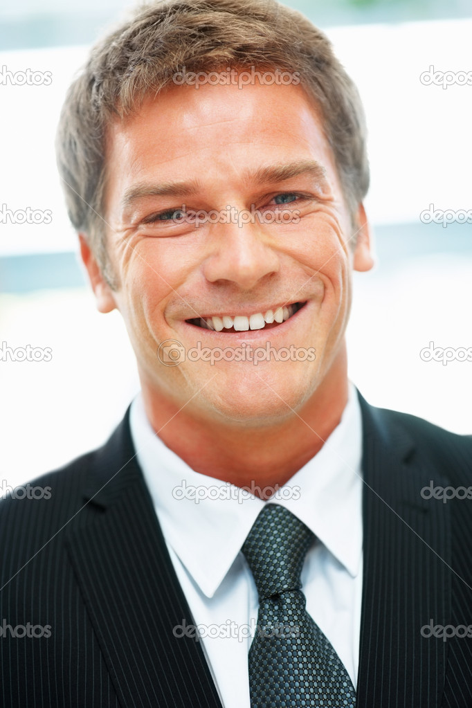 Closeup view of handsome executive smiling — Stock Photo #7784898
