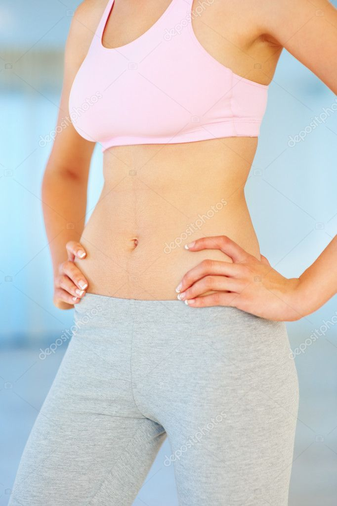 Mid section of fitness young woman with hands on hips  Stock Photo #7786488