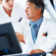 Royalty-Free Stock Photo: Doctors examining medical report