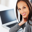 Royalty-Free Stock Photo: Smiling woman using laptop