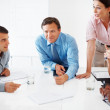 Business team in discussion - Stock Photo