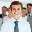 Royalty-Free Stock Photo: Happy business man with colleagues in background