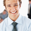 Royalty-Free Stock Photo: Handsome young businessman smiling at office
