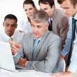 Senior businessman discussing work with his colleagues - Stock Photo