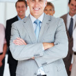 Royalty-Free Stock Photo: Smart senior manager standing with his team at the back
