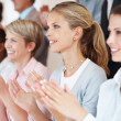 Royalty-Free Stock Photo: Business woman with colleagues applauding at a seminar