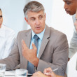 Senior executive planning new working concepts with his team - Stock Photo
