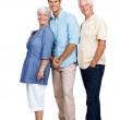 Happy young man standing with his parents on white - Stock Photo