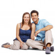 Beautiful young couple sitting together - Stock Photo