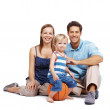 Beautiful young couple with their cute kid against white - Stock Photo